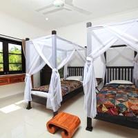 De vakantievilla op Bali heeft ook een slaapkamer met twee éénpersoonsbedden.
